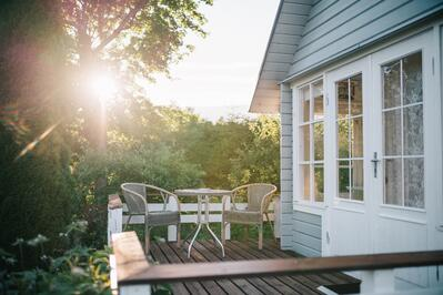 Sunny view of a home's side porch