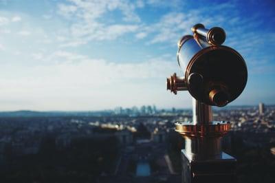 Periscope over city horizon