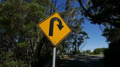 180 degree curve street sign