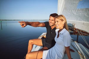 growing your portfolio turnkey real estate long term wealth couple on boat